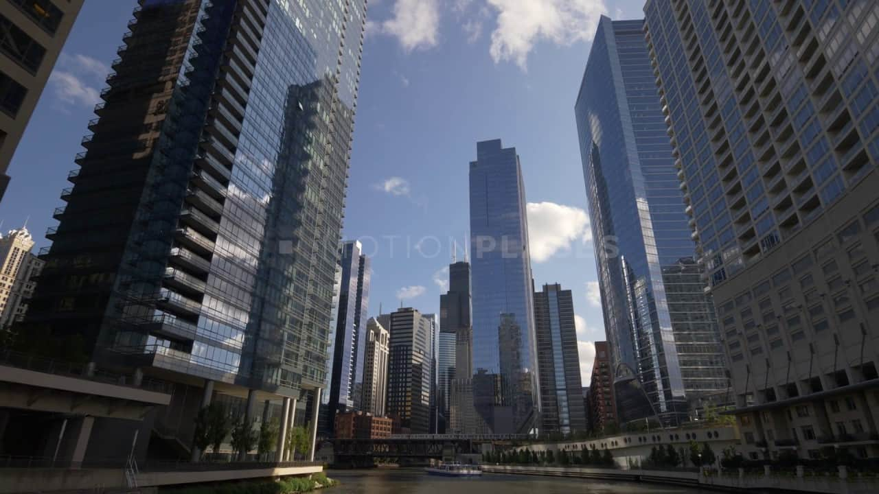 Chicago River City View Stock Footage by Motion Places. Download our free HD video footage, or purchase high quality 4K clips. Royalty Free licensing.