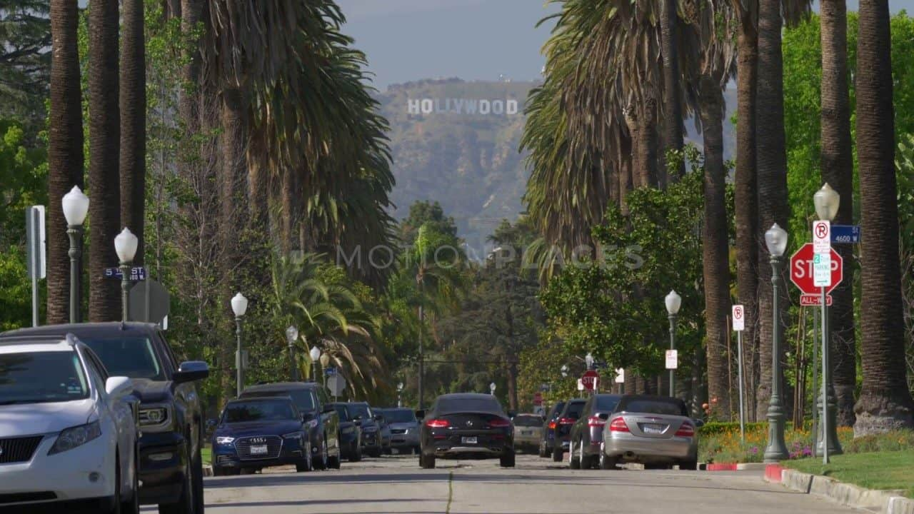 Hollywood Sign Palm Tree Street Free Stock Footage by Motion Places. Download our free HD video footage, or purchase high quality 4K clips. Royalty Free licensing.