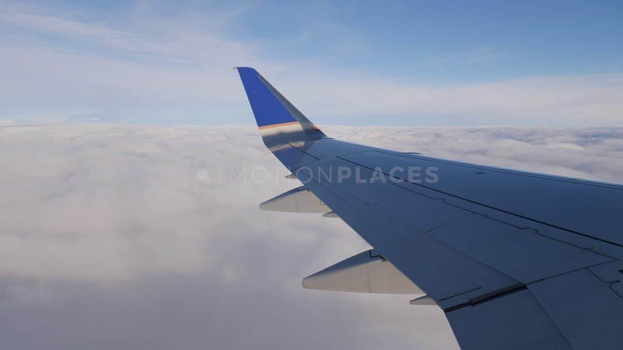 Airplane Wing Above Clouds Free Stock Footage by Motion Places. Download our free HD video footage, or purchase high quality 4K clips. Royalty Free licensing.